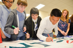 "Port Chester High School students sign the ""Don't Stand By, Stand Up"" banner, part of a three-week-long anti-bullying campaign organized by the 21st Century ASPIRE after school program's advisory board in April 2012. From left: Kyle Thomas, 11th grade, Lukas Patrizio, 11th grade, Jeffrey Quinde, 11th grade, Eduardo Gonzalez, 11th grade, and Brooke Pietrafesa, 9th grade."