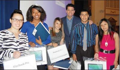 Five Port Chester High School seniors who received laptops from To the Top with Laptops (TTT) at the school's senior awards ceremony pose with the founder of the non-profit that provided them. From left: Emily De Diago, Janay Haywood, Evelyn Brito, TTT founder Robert Drechsler, Sergio Ortega and Alicia Barreto.