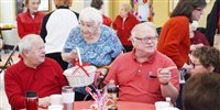 Valentine's Day luncheon fills the room with red